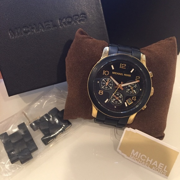 1d8ab5ded101 Michael Kors Black and Gold Womens Watch. M 580babe7c6c795e24c00c46e