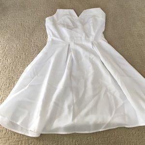 white, sleeveless, back cut out, skater dress
