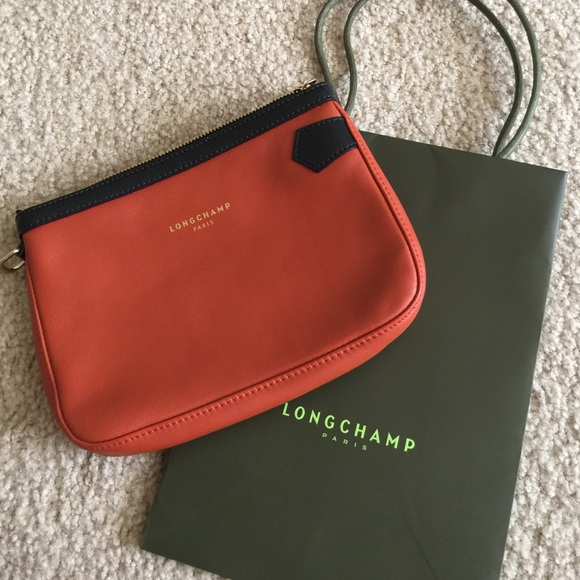 42% off Longchamp Handbags - Authentic Longchamp pouch bag from ...
