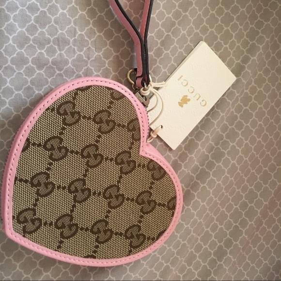 1c0f658fbfd9 Gucci Handbags - Gucci 💗 shape kids wristlet or coin purse!