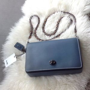 Never worn: COACH  dinky crossbody bag