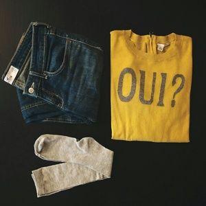 "Mustard fall ""Oui?"" sweater."
