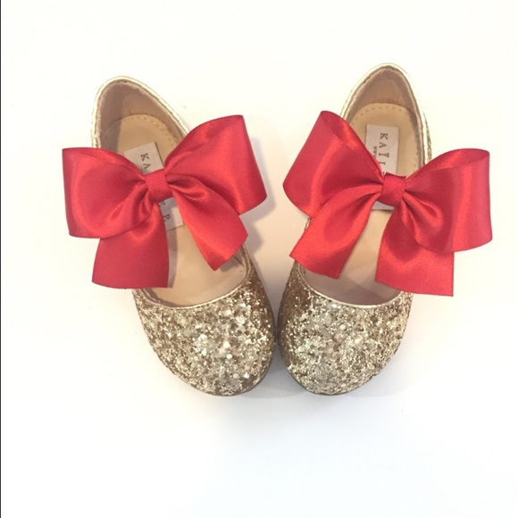 b95da79c404e Gold glitter with red satin bow