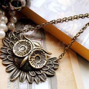 Owl necklace in antique gold tone