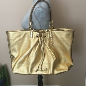 Juicy Couture gold leather tote