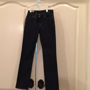 New with tags dstld cigarette mid rise jeans.