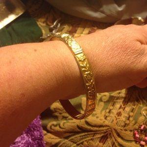 Gold toned bangle bracelet.