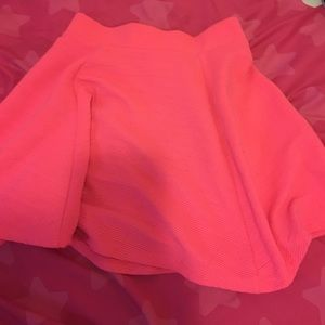 Bright pink H&m skirt.