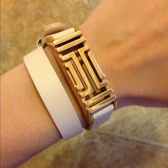 446d98a442ec Gold Tory Burch Fitbit Bracelet. M 58163fd4f0137d4dd70cb3b0