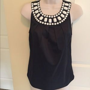 Beautiful black and white top with stones size XS