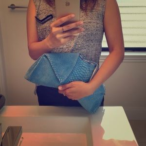 Emily Cho python embossed leather clutch!