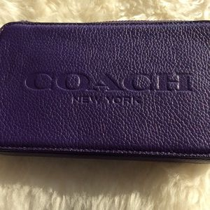 Coach hang tag utility case