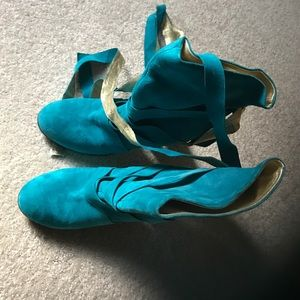Marc Jacobs blue suede boots with tie details.