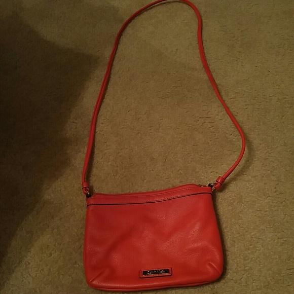 eb88ee9ed41c Calvin Klein Handbags - Calvin Klein Red Pebbled Leather Crossbody Bag