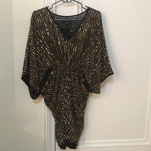 Black ABS dress with gold sequins.