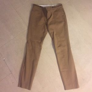 Tan Zara pants with gold zipper accents.