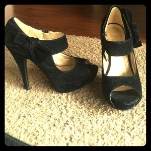 Black faux suade heels, with bow accent