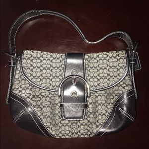 Black coach Monogram Leather Trim Buckle Handbag