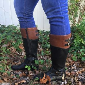 Tan and black riding boots