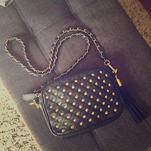 Black crossbody bag with studs and tassel