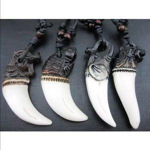 Carved yak bone protection amulet pendant