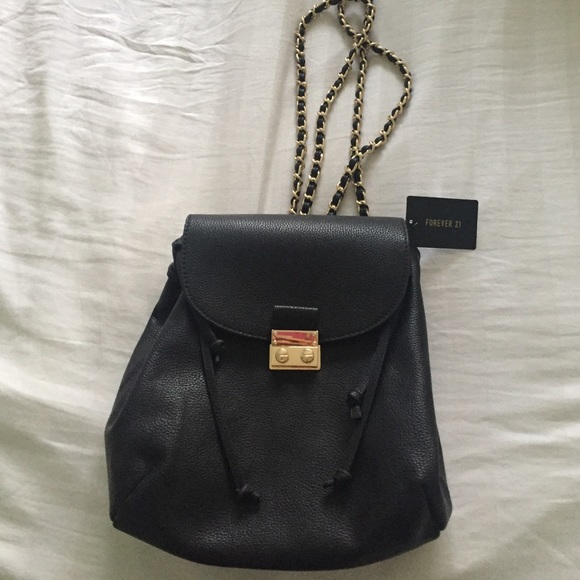 355a6a27c369 Black and gold mini backpack purse