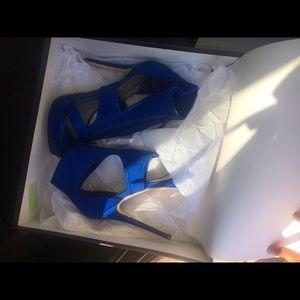 Brand new never worn! blue BeBe heels.