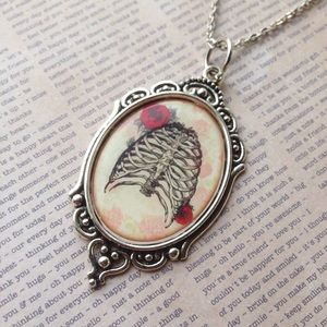 Abbie's Anchor Jewelry - Ribcage with roses cameo necklace