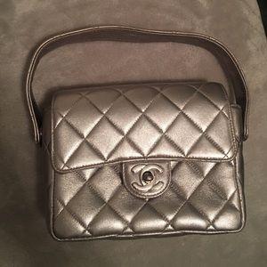 CHANEL Handbags - Chanel Silver Metallic Quilted Mini Flap Bag