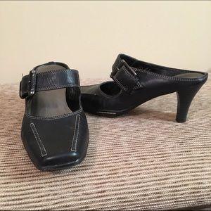 Women's black leather slip on shoe.