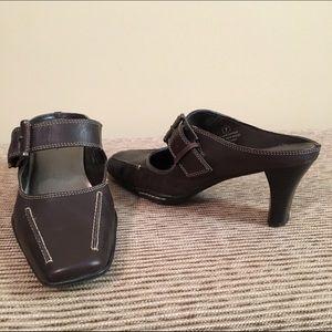 Women's brown leather slip on shoe.