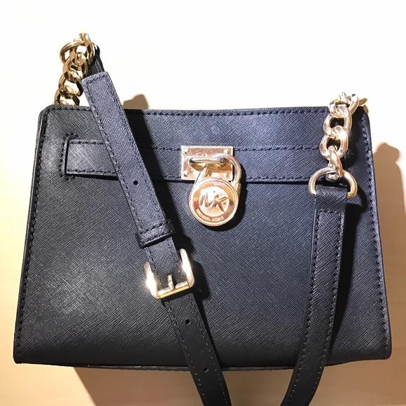 michael kors purse lock