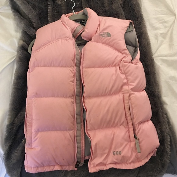 cae1aa58fbd3 ... new style pink puffy north face vest ab54f 6d5ee