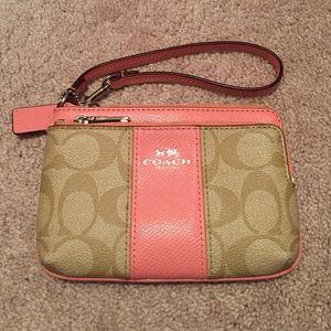 Coach Handbags - Pink and tan coach wristlet