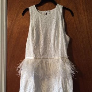 White lace and feather peplum dress