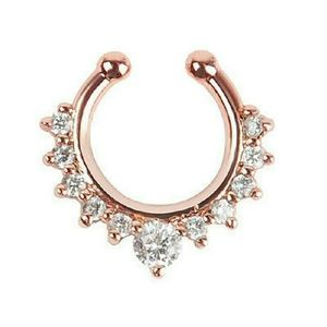 Rose gold tone and crystal septum ring.