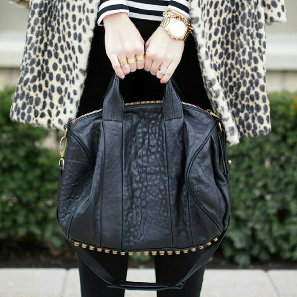 Alexa Studded Calfskin Leather. M 582953b3620ff7d3690a502a 42f7c1613f54b