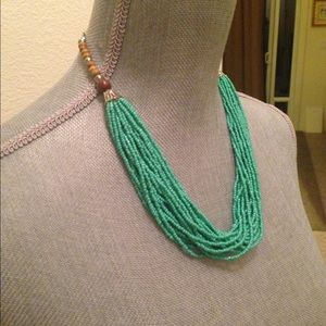 Multi-strand bead necklace.