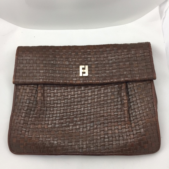 673c212bc43e Fendi Handbags - Vintage Fendi Woven Leather Clutch!
