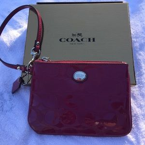 Fuchsia Coach Wristlet with box and care info