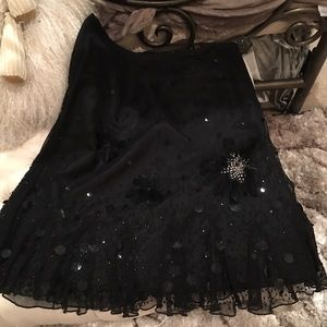 Que Dresses & Skirts - Black embellished skirt w sequin & feather detail