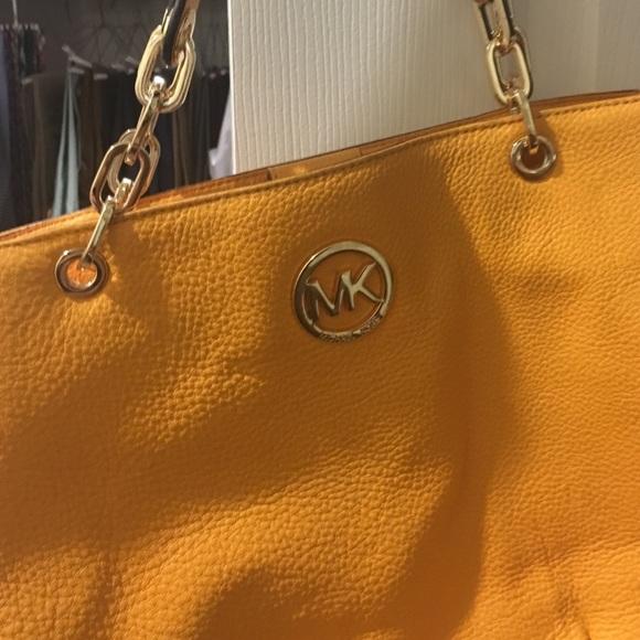 529c063277cff8 Michael Kors mustard color purse. M_5828e8ad13302a2d7a0886ab