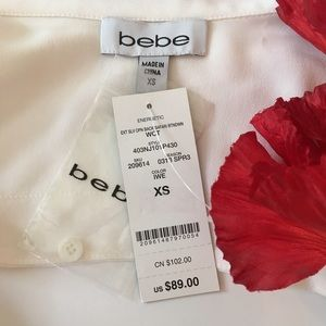 bebe Tops - Bebe sleeveless button-down open drape back top