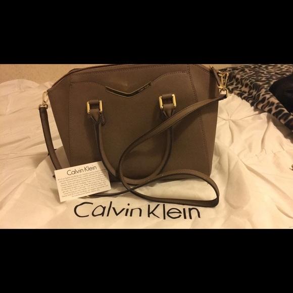 1285b3e0a9b Calvin Klein Handbags - Calvin Klein tapered Saffiano leather satchel