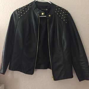 Fitted faux leather jacket with gold studs