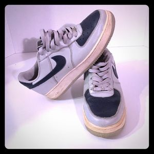 Gray and navy blue Air Force Ones