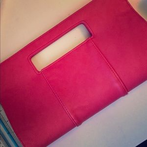 Handbags - Fun clutch adds a pop of color to any outfit!