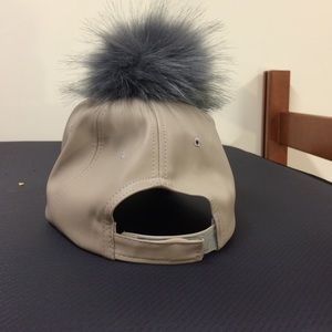d50bd9c5bdb Accessories - Nude grey puff ball hat never worn.