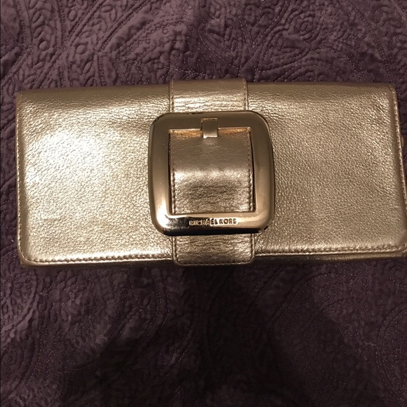 68 off michael kors handbags michael kors gold clutch from nicole 39 s closet on poshmark. Black Bedroom Furniture Sets. Home Design Ideas
