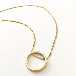Express gold circle long necklace